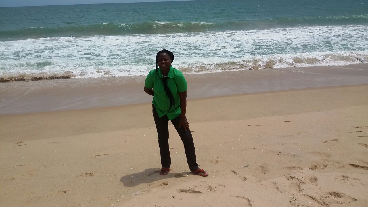 Mary at a beach in Lagos